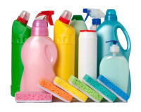 Colorful containers with cleaning supplies